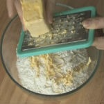 We rub margarine on a grater