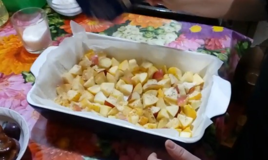 spread apples and plums on the bottom of the pan