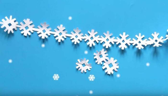 гирлянда из снежинок из бумаги